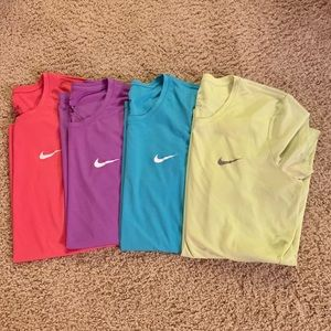 A set of 4 Nike Dri-Fit Shirts in Various Colors